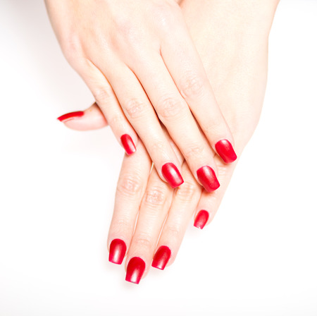 bodypart: Woman hand with red nails isolated, manicure concept