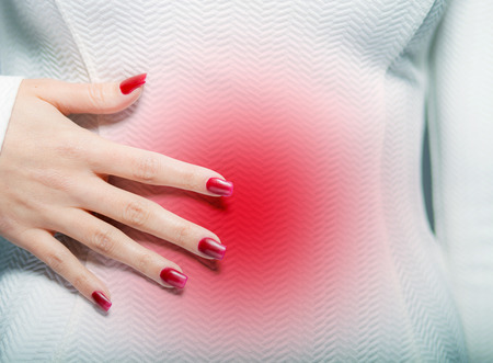 Woman having stomach ache or menstrual pain