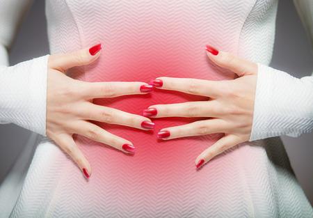 menstrual pain: Woman having stomach ache or menstrual pain