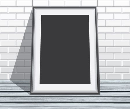 empty frame: Empty frame on floor and brick wall