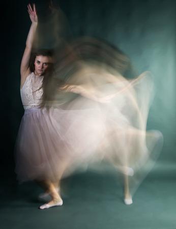 Ballet dancer woman in motion blur, ballerina