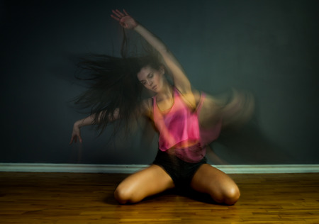 motion blur: Modern hip hop dancer woman in motion blur