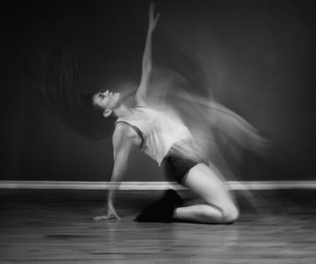 Modern hip hop dancer woman in motion blur