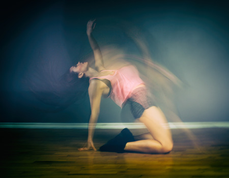 Modern hip hop dancer woman in motion blur