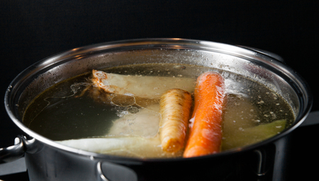 bouillon: Cooking base of chicken soup, bouillon in pot with vegetables Stock Photo