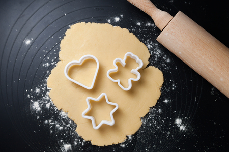 cookie cutter: Various shaped cookie cutter on dough preparing cookies concept