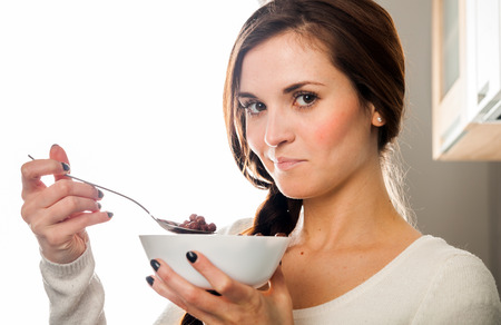 breakfast bowl: Woman with bowl of coco cereal, breakfast in home