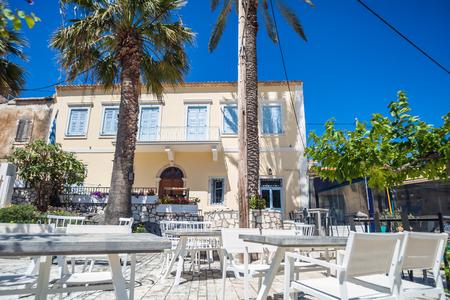 outdoor restaurant: Small cozy outdoor restaurant in summer day Greece