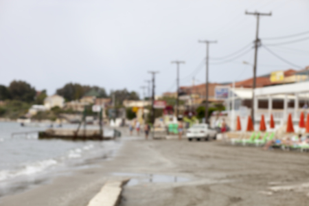 neglected: Blurred small tourist town and neglected beach, defocused background