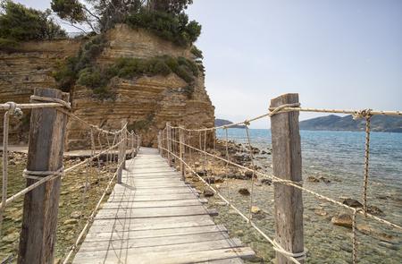 zakynthos: Hanging wooden bridge over the sea, Cameo Island Zakynthos Greece Stock Photo