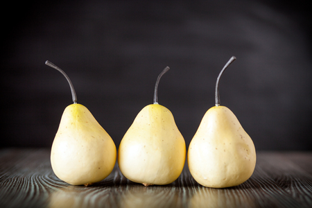 ingradient: Pears on wooden desk dark background, front view