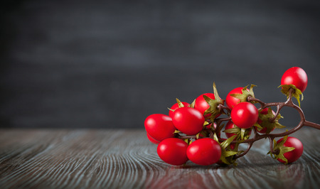 ingradient: Cherry tomatoes on wooden table dark background, copy space Stock Photo