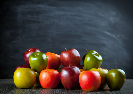 ingradient: Colorful apples on wooden table dark background, copy space Stock Photo