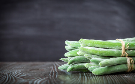 ingradient: Asparagus on wooden table dark background, copy space Stock Photo