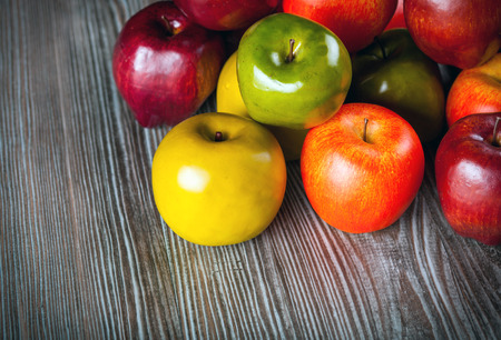 ingradient: Red apples on wooden table close up, top view