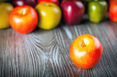 ingradient: Red apples on wooden table close up, front view
