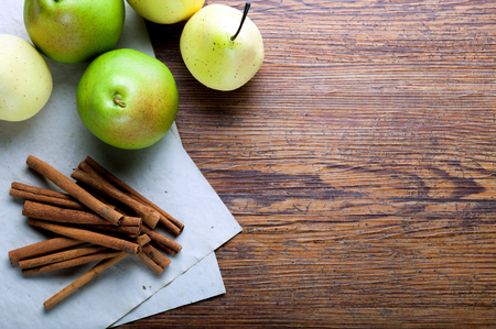 ingradient: Ripe pears and cinnamon sticks on rustic wooden board with copy space Stock Photo