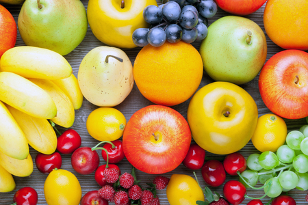 Fresh mixed fruits on wooden board, concept of healthy eating and diet Stock Photo