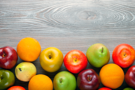 ingradient: Apples pears and oranges on wooden board, background with copy space