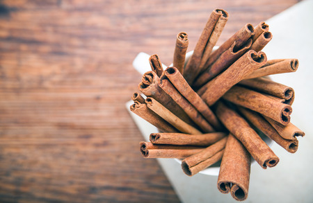 ingradient: Cinnamon sticks on rustic paper close up with, copy space