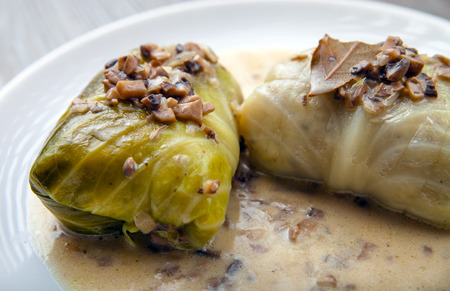 Stuffed cabbage meat in leaves with mushroom sauce, Golabki popular Polish dish Stock Photo