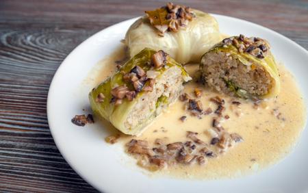 farci: Stuffed cabbage meat in leaves with mushroom sauce, Golabki popular Polish dish Stock Photo