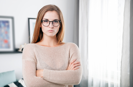 Young beautiful woman with eyeglasses at her home