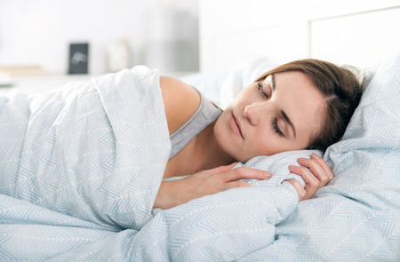 peacefully: Woman peacefully sleeping in the morning before waking up