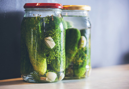 pickling: Pickled cucumbers in a jar with spices and herbs, copy space Stock Photo