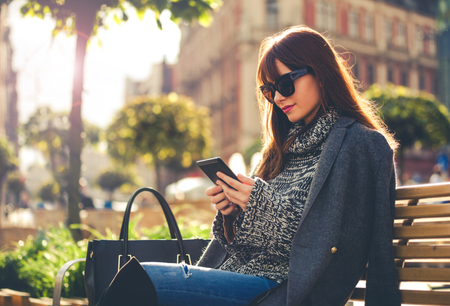 Ebook reader stock photos pictures royalty free ebook reader pretty woman using tablet or ebook reader sitting in town street urban scene fandeluxe Ebook collections
