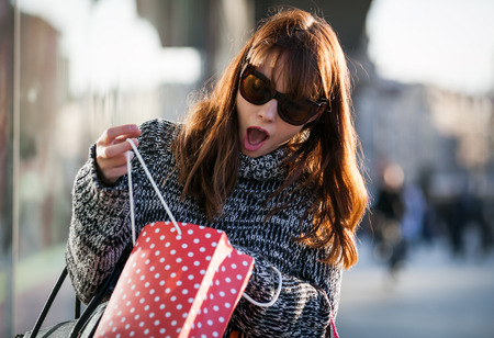 Shocked woman with shopping bags forgot purchase something