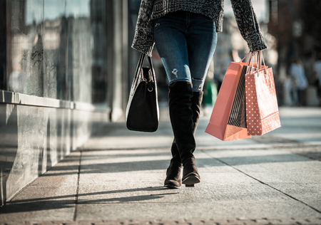 go shopping: Woman on street with shopping bags, close up