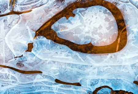 Beautiful frozen water with ice structure, nature texture background
