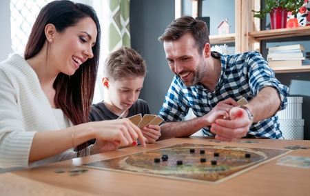 Happy family playing board game at home, happiness concept Stok Fotoğraf - 96956294