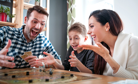 Happy family playing board game at home, happiness concept Фото со стока - 101085812