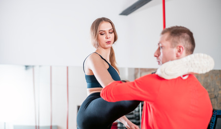 Fit couple stretching together before training at fitness gym Stock Photo