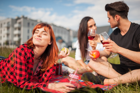 Having fun at picnic in front of residential area, group of happy neighbors hanging out near houses Stockfoto