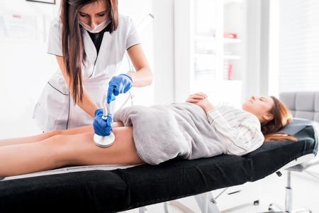 Anti-cellulite treatment at medical spa center, vacuum massage procedure Reklamní fotografie