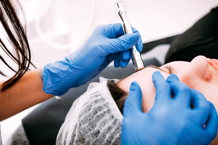 Professional skin care, procedure Microdermabrasion of the facial skin at cosmetic clinic