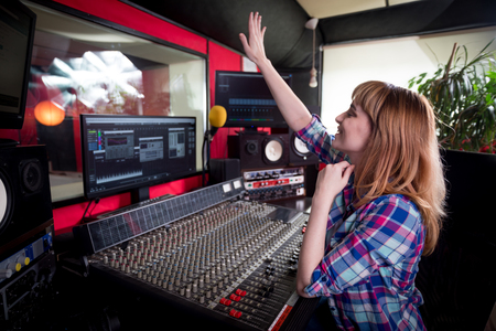 Sound recording studio mixing desk, sound engineer or music producer working at new song