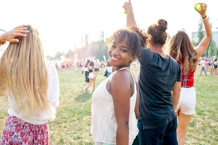 Group of friends having fun at summer music festival Stock Photo