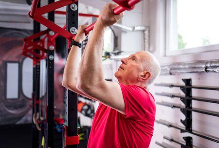 Senior man at the gym Reklamní fotografie - 127358358