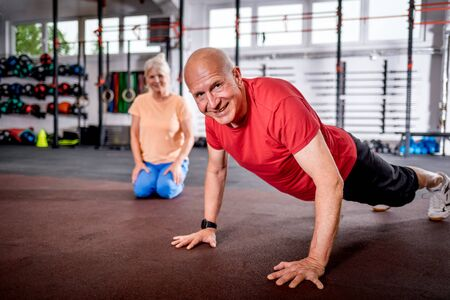 Senior people doing rehab workout at the gym Reklamní fotografie - 127358360