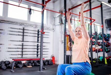 Senior woman during rehab in the rehabilitation center Reklamní fotografie - 127359330