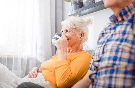 Senior couple at home spending time together drinking tea or coffee Reklamní fotografie - 127359350
