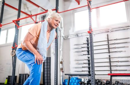 Senior woman at the gym suffering from pain in knee Reklamní fotografie - 127359360