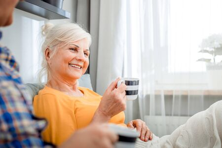 Senior couple at home spending time together drinking tea or coffee Reklamní fotografie - 127359464
