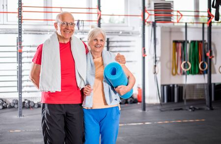 Senior couple ine the fitness club Reklamní fotografie