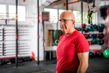 Senior man at the gym Reklamní fotografie - 127359568