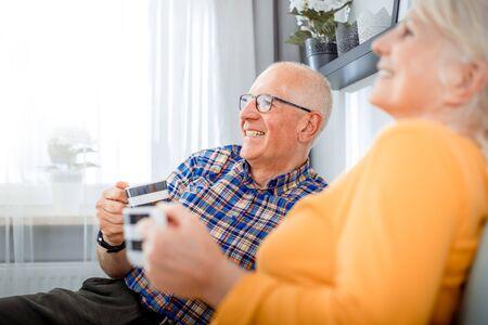 Senior couple at home spending time together drinking tea or coffee Reklamní fotografie